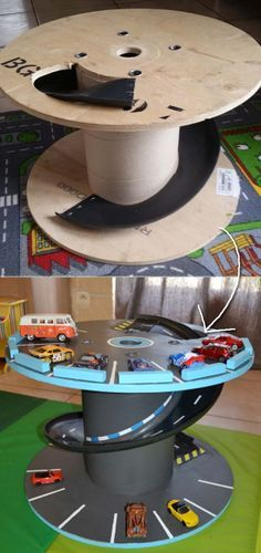 Use an old cable spool to create this surprising toy car station.