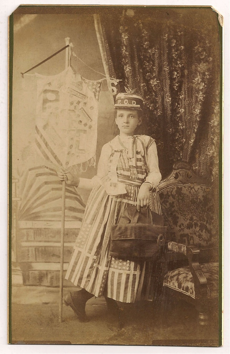 Flag Dress Pittsburg Kansas 1889.  Banner Ad woman; in this case it is a young girl who is holding the banner.  Advertising cabinet card