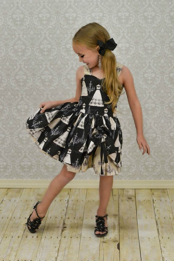 Like your little one, this black boutique dress defies easy definition and is full of sparkling personality. Inspired by the glamour of black tie weddings, Parisian fashions, and all things special this custom girls dress was created in the fashion of a chandelier dress for proper celebrations.  #waverlywadedesigns