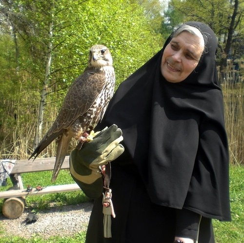 Nun with bird of prey