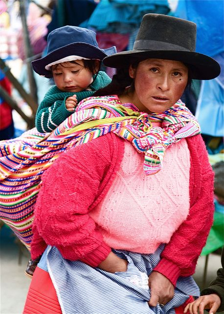 South America | Portrait of a Aymara mother wearing traditional clothing and carrying her child, Yauli, Peru | © Hideki Naito