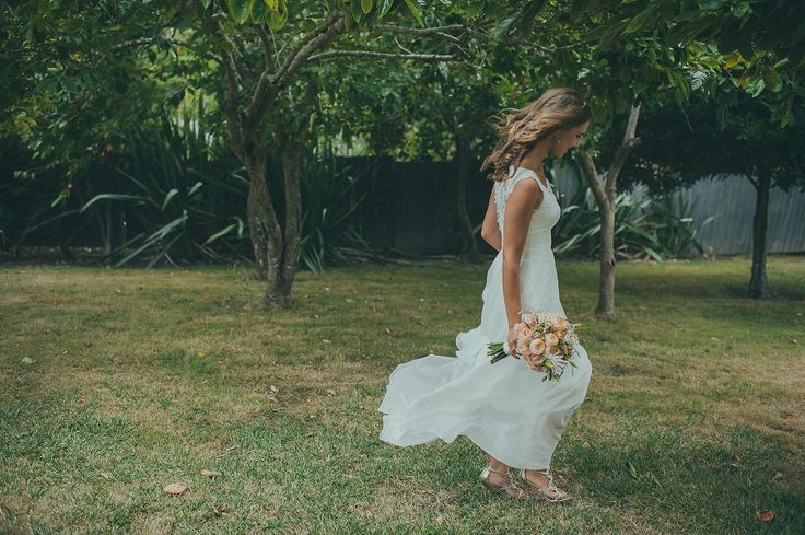 Our bride Ekatherina on her wedding day. Love the silk chiffon skirt blowing in the breeze. The bride said the day was really windy, but it made for good photos. Image by Jake. #realwedding #realbride #nzwedding