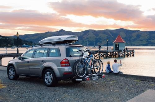 Nice and organized with a cargo box and a hitch bike rack