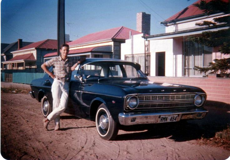 My 1967 Ford XR Falcon 500 with me alongside out the front of my parents house in 1967 (road being upgraded at the time).
