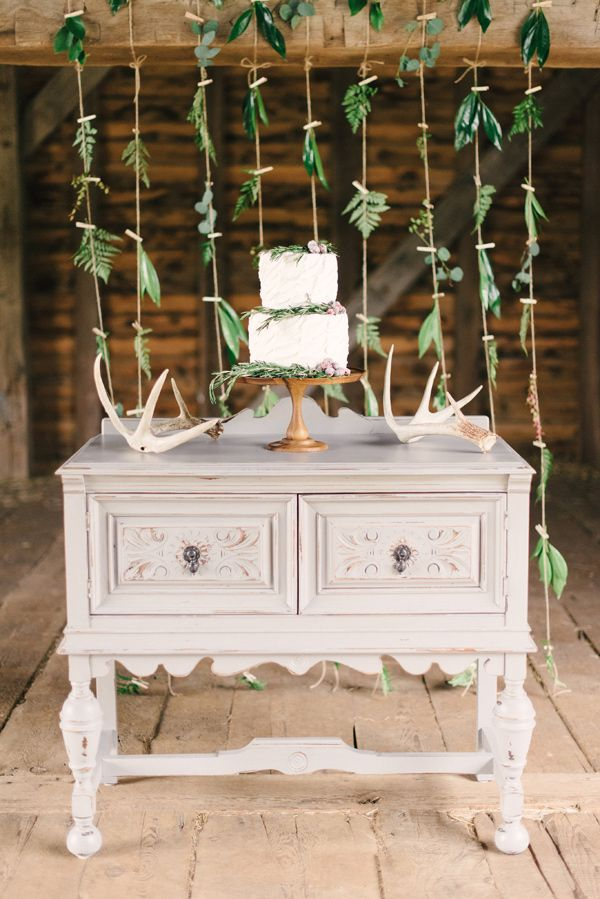 cake table with greenery backdrop - photo by Briana Arlene Photography http://ruffledblog.com/airy-romantic-wedding-inspiration