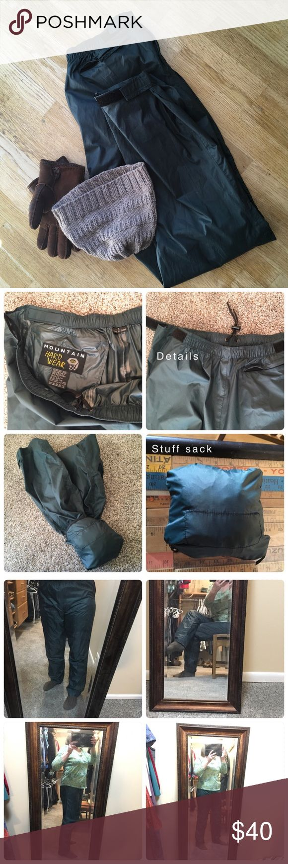 """🍫 Rain Pants by Mountain Hard Wear Quick slip on pant with pull on waist construction with adjustability. The Velcro closures at waist and cuff seal away the elements. Fabric is 100 % nylon. Color is dark green as shown in first photo. Zippered back pocket can also be used as a stuff sack to make it easy to pack along for the unexpected rain storm when out and about. Measurements are 13"""" front rise from top of waist to seam between the legs, inseam 31.5"""", waist flat then doubled 33"""". Comes…"""