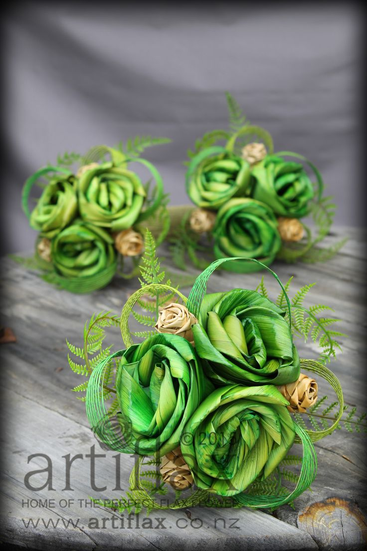 Nature inspired flax flower bridal bouquets by Artiflax.  Fresh greens and natural flax roses with ferns and hapene flax ribbon