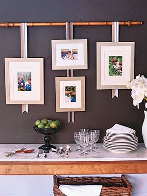 i love the idea of these hanging picture frames especially the bamboo stick - Wall Hanging Photo Frames Designs