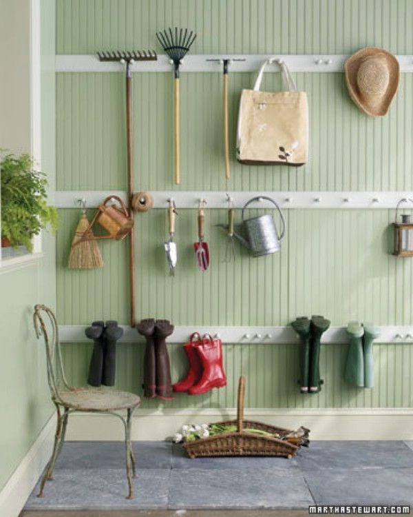 Adding simple pegs to the wall or to boards to hang on the wall is a great way to get organized.