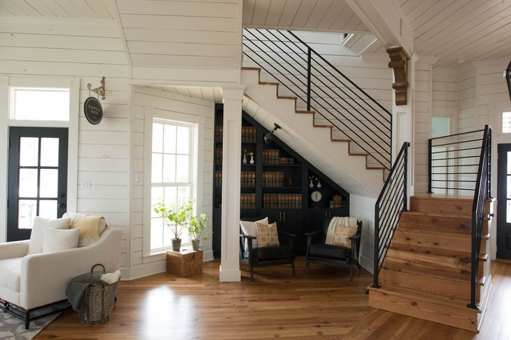 A small library and reading nook under the stairs. From HGTV's Fixer Upper's rental, Magnolia House.