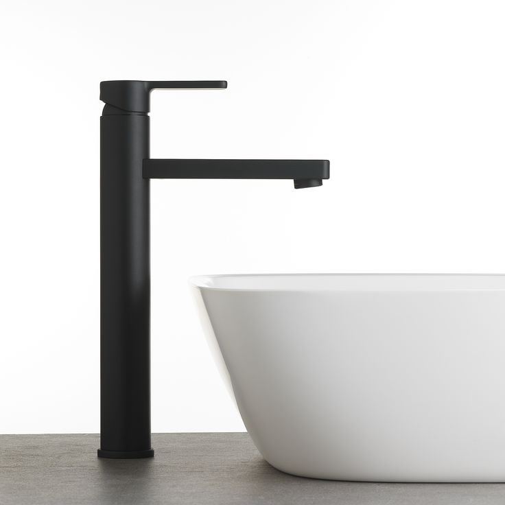 A Zeos Tower Basin Mixer in our Switzrok Matte Black finish looks stunning with a homogenous stone Silkstone Elbe Basin, also available from #faucetstrommen