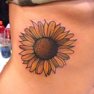 A sunflower is of course a classic choice for any '90s girl. Especially ones with Blossom Russo obsessions.   31 Super Cute Tattoos For '90s Girls