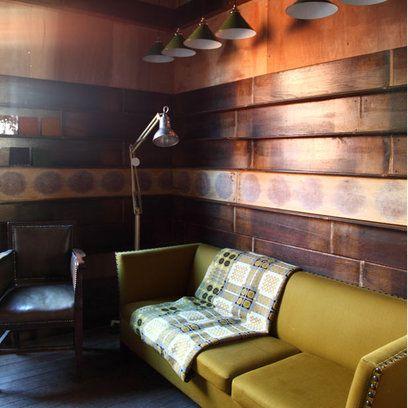 Inspiring Interiors: Living Room: New Rustic - wood panelling, mustard sofa