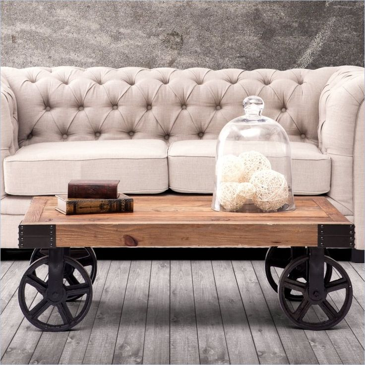 Zuo Barbary Coast Cart Coffee Table in Distressed Natural - An early 1900s industrial original once used to transport furniture, fabric and supplies across the factory floor. The cart is made from solid elm and the wheels are antiqued metal.