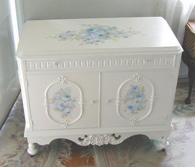 Blue floral on white by Debi Coules.  I really like this.  I have a quilte chest almost identical to this that I'd like to re-paint.
