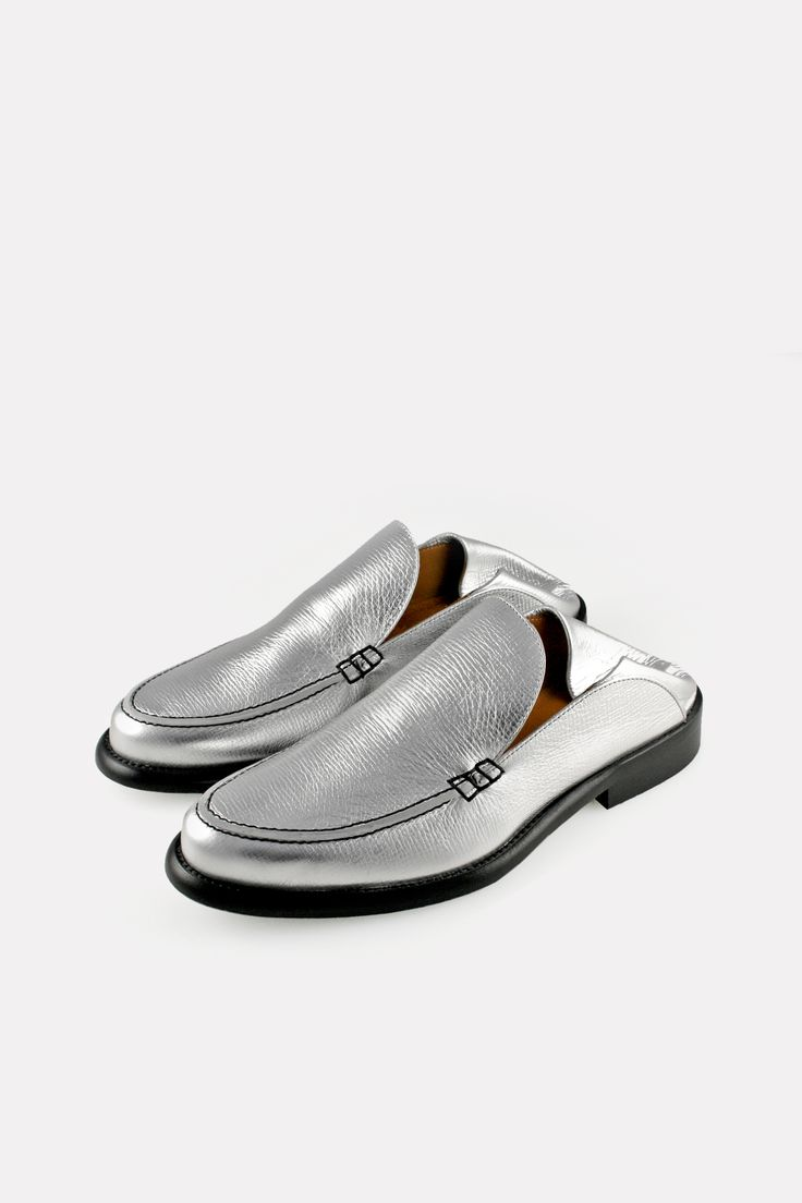 INSPIRED BY THE TRADITIONAL BABOUCHE - THIS STEP-DOWN, FLATTENED IN THE BACK VERSION OF THE traditional moccasin stitch loafer CUTS A RELAXED, NONCHALANT SILHOUETTE A clean slip-on slightly chunky loafer construction with moccasin stitch plug and heavy sole in textured silver calf LEATHER SOLE, KID