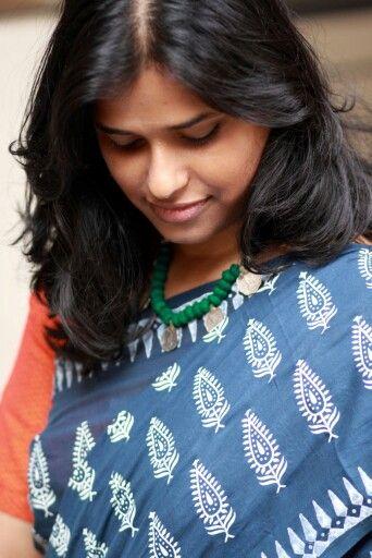 White motifs on an Indigo mulmul saree