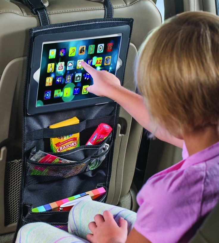 Now you can build your own theater in the backseat for small children with help from the iPad Car Organizer. The built-in tablet holder can display any tablet measuring up to 7-1/2 by 9-1/2 inches, allowing children to watch movies or play games during long car rides. Several storage pockets and elastic loops offer tons of storage room for toys, electronic accessories, snacks, and other entertainment items. Add this backseat media organizer to your car to give kids or adults something to…