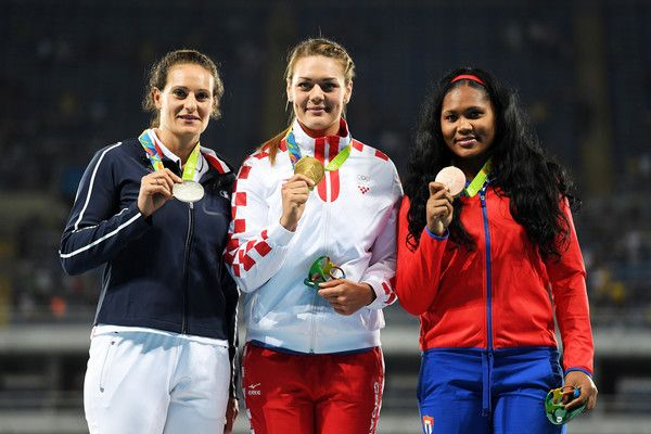 (L-R) Silver medalist Melina Robert-Michon of France, gold medalist Sandra Perkovic of Croatia and bronze medalist Denia Caballero of Cuba pose during the medal ceremony for the Women's Discus Throw Final on Day 11 of the Rio 2016 Olympic Games at the Olympic Stadium on August 16, 2016 in Rio de Janeiro, Brazil.