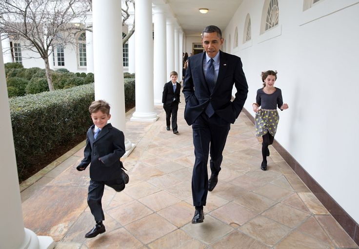 "January 25, 2013 ""On a cold day, the President races down the Colonnade with Denis McDonough's children en route to the announcement that Denis would become the new Chief of Staff."" (Official White House Photo by Pete Souza)"