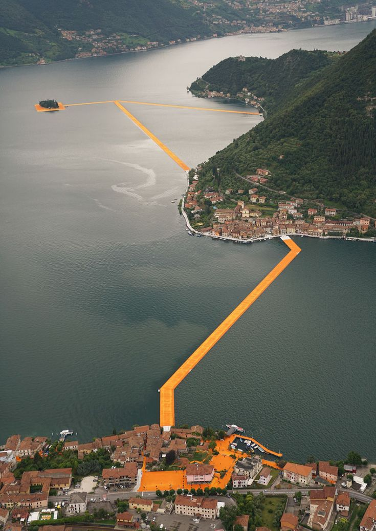 Anyone who's dreamed of walking on water now has the chance to do so! Well, that is if you could make it to Lake Iseo in northern Italy in the next three weeks. Just opened on Saturday and accessible until July 3rd is Christo's and his late wife's, Jeanne-Claude's, major installation - The Floating Piers. This 3km (almost 2 miles) floating walkway across Italy's lake Iseo is made of 200,000 high-density polyethylene cubes and is covered in 100,000 square meters of shimmering yellow fabric…