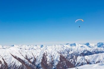 Freedom as a paraskier floats above the backcountry at Cardrona Alpine Resort, Wanaka, New Zealand. - Buy this print | Box of Light - Surf + Lifestyle + Mountains