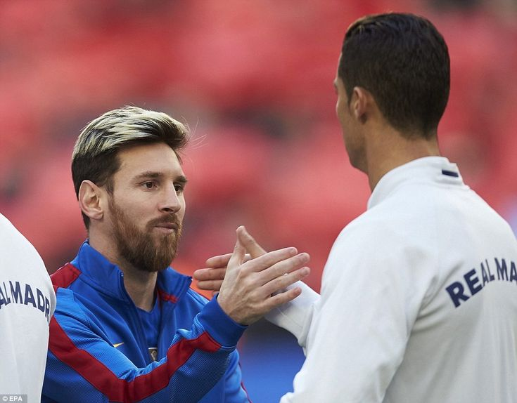 Lionel Messi and Cristiano Ronaldo embrace as the two teams line up ahead of kick-off at the Nou Camp on Saturday