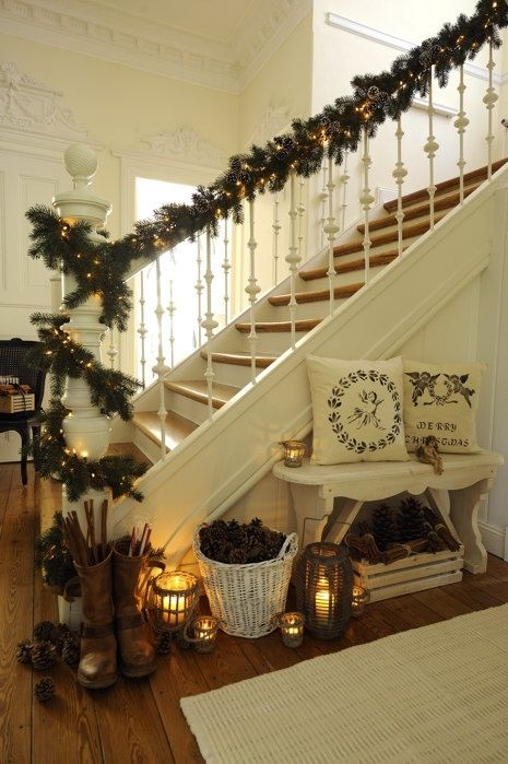 Christmas Entryway | Warm & Welcoming Lanterns. I love the boots and pillows too