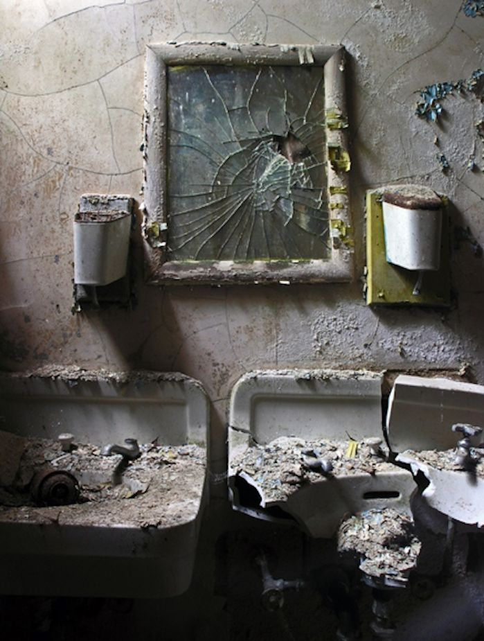 Angry are the forgotten -- broken mirror, ruined sinks, decay decay decay