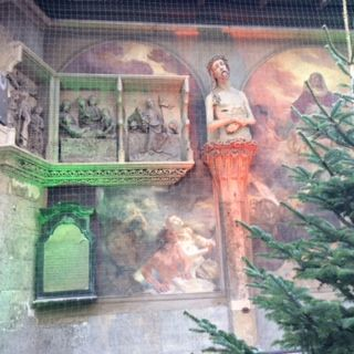 Der Zahnwehhergott aka Our Lord of the Tootache, with reconstructed murals on the outer wall of the Cathedral of St Stephen