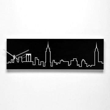New York Skyline Black now featured on Fab.Originally designed by Richard Paolino for Progetti, the New York Skyline Wall Clock features the epic New York skyline vividly outlined in white on a wood panel painted black. Featuring the Chrysler building and the Empire State building amid lower rooflines, this Progetti clock cleverly uses the Brooklyn Bridge as the base of the clock face.