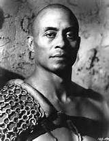 "Woodrow Wilson Woolwine ""Woody"" Strode (July 25, 1914 – December 31, 1994) was an African American decathlete and football star who went on to become a film actor. He was nominated for a Golden Globe award for Best Supporting Actor for his role in Spartacus in 1960."