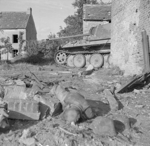 A knocked-out German Panther tank and a dead infantryman in the Falaise pocket, 25 August 1944