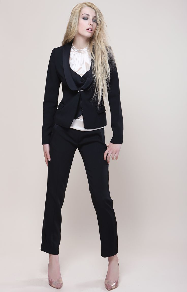 Black skinny trousers and a black jacket with jilet. White top.   Outfit proudly made in Italy