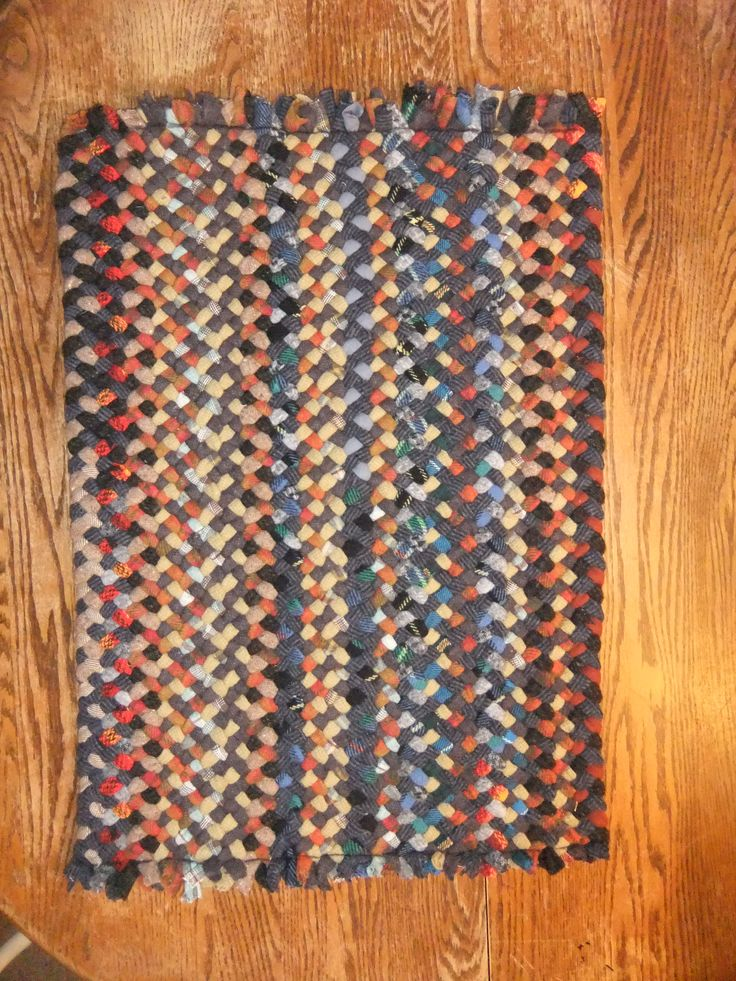 hand braided rectangular rug by Val Galvin, Renditions in Rags Hand Hooked and Braided rugs, using recycled and reclaimed wool.