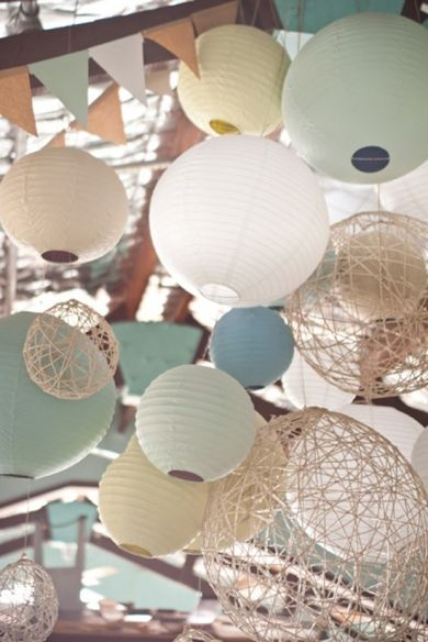 I Like The Mix Of Colors Textures These Paper Lantern Decorations Via Katie And Alexs Relaxed Waterside Wedding