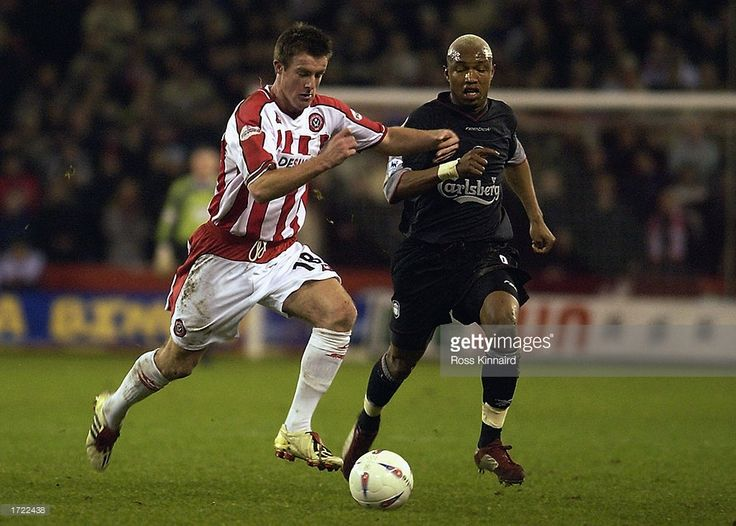 Michael Tonge of Sheffield United looks to reach the ball ahead of El Hadji Diouf of Liverpool during the Worthington Cup semi-final first leg match held on January 8, 2003 at Bramall Lane, in Sheffield, England. Sheffield United won the match 2-1.