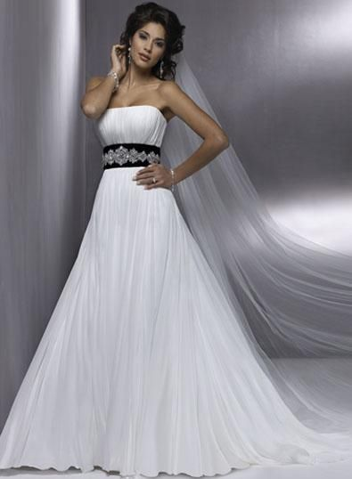 White Wedding Dress With Black Accents at Exclusive Wedding ...