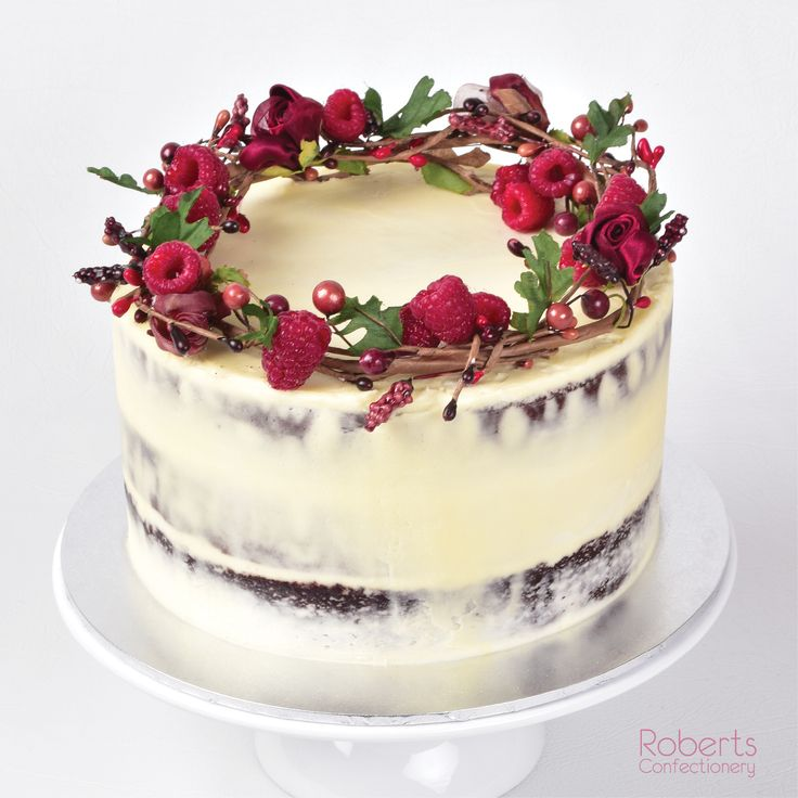 Chocolate Rustic Naked Cake with floral & fruit wreath.