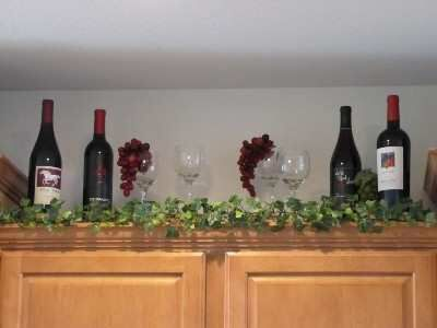 17 best images about christmas kitchen on pinterest for Wine and grape themed kitchen ideas