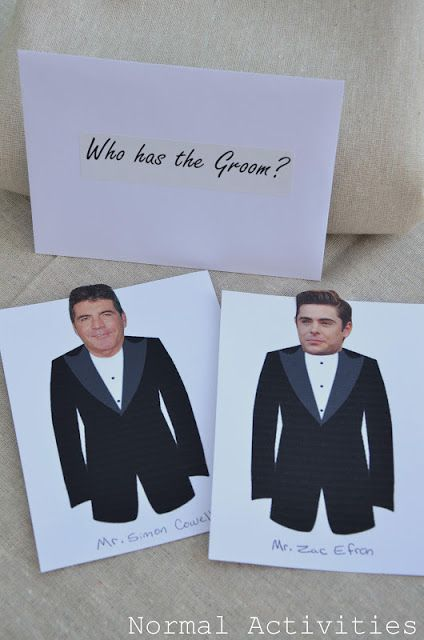 """Taped to the bottom of each guest's chair was an envelope that said """"who has the groom?"""" Inside the envelopes was a print out of a tuxedo that had a picture of a celebrity male's head attached. In one envelope, instead of a celebrity was the groom's head and the lucky person with that envelope won the door prize!"""