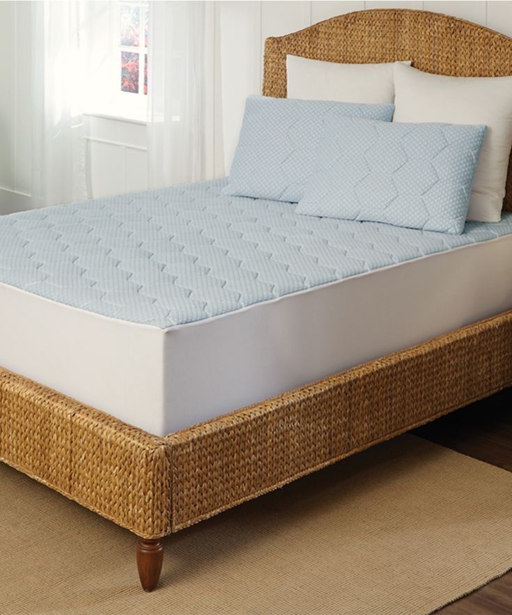 Instantly boost a bed's comfort level with this snuggly soft mattress pad that makes the Dreamland send-off a breeze. Its cooling construction helps regulate heat buildup for a more optimal sleeping temperature range. Fits mattresses up to 22'' deepTop: 100% rayon topMiddle, bottom and skirt: 100% polyesterBack: 100% non-woven polyethyleneCover: 240 GSMBack: 80 GSMHypoallergenicMachine wash; tumble dryImported