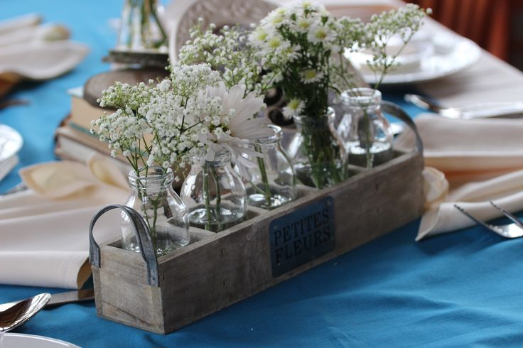 I have 11 wooden milk crates that we used as part of a rustic/vintage centerpiece arrangement. I got these from Save On Crafts so if you need more, you can get them. I am asking $75.00 for all 11 crates. Each crate has 5 glass milk bottles that are perfect for flowers - we used baby's breath and wild flowers.  Read more: http://www.weddingbee.com/classifieds/show-ad/?id=43363/#ixzz31kkBejVc