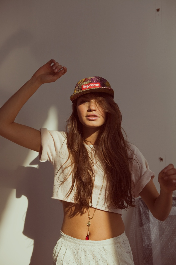 chose this photo because i like hipster girls and she is wearing a supreme 5 panel