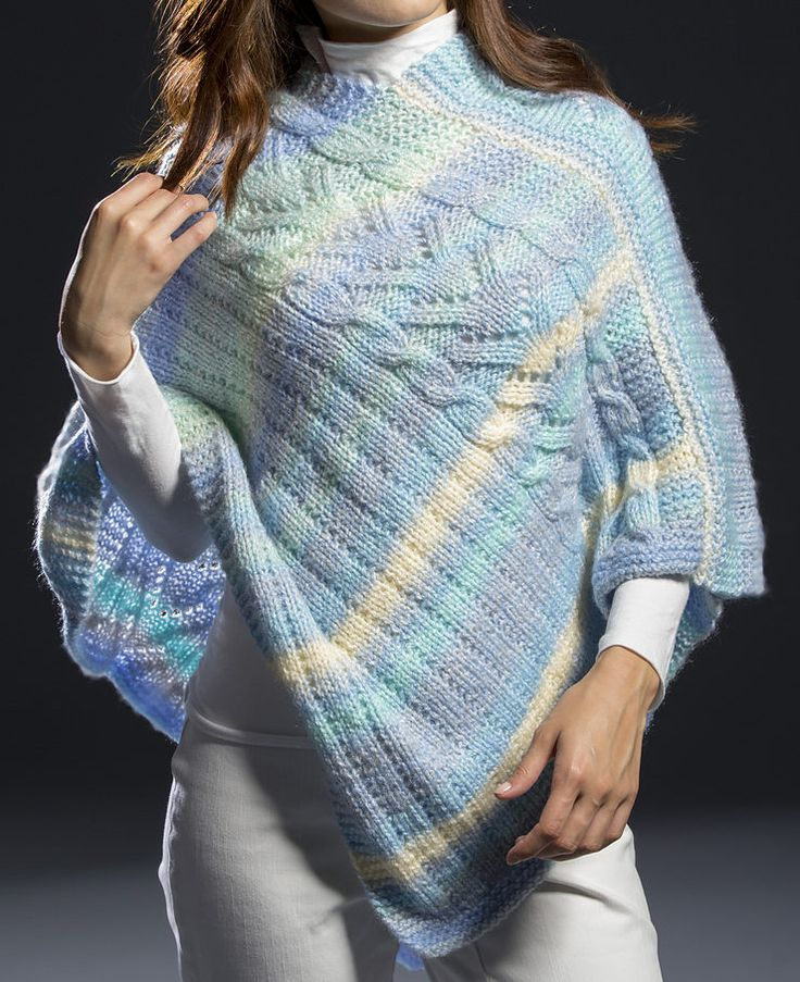 Free Knitting Pattern for Surfside Poncho 2 pieces 10-row repeat - Poncho knit with 2 panels with a 10 row repeat of cable, lace, stockinette, and eyelet, and then the panels are sewn together. Bulky yarn. Designed by Premier Yarns