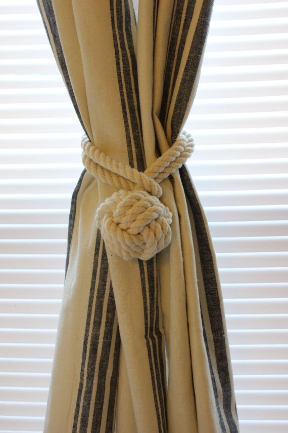 This listing is for two curtain tiebacks. They are handmade with your choice of either organic cotton or manila rope and tied in the classic monkeys