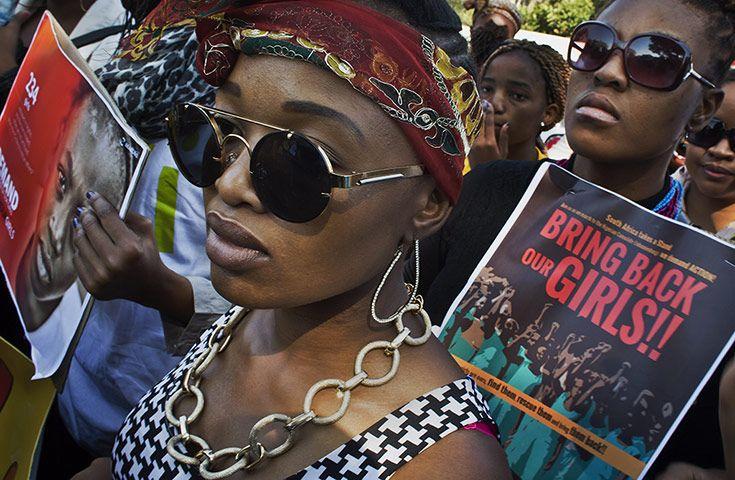 Credit: Ben Curtis/AP In this photograph by Ben Curtis, South Africans protest against the abduction of hundreds of schoolgirls in Nigeria b...