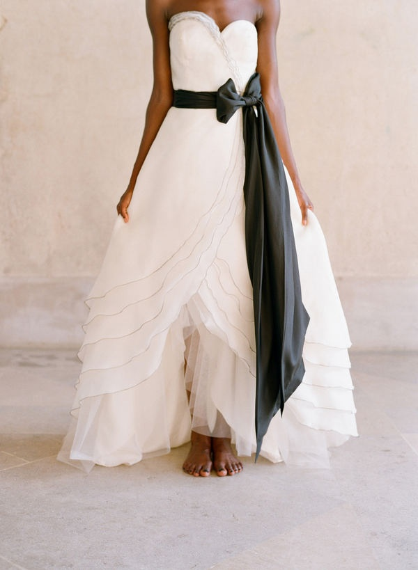 Black detail is set to be a hot bridal trend for 2014 - love how this black sash adds drama to a pretty gown