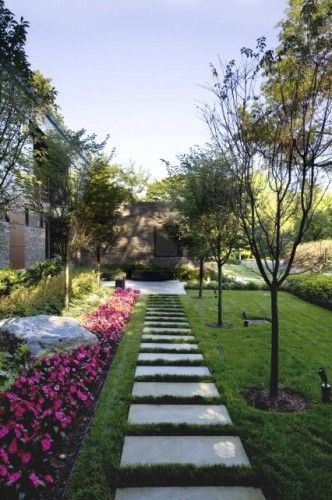 Love square concrete pavers with grass around for walk ways patios and even pool decking
