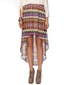 A sheer skirt featuring a vibrant tribal pattern. High-low tail hem. Elasticized waistline. Partial lining. Woven. Lightweight.    DETAILS:  - 17' - 38' approx. length from waist to hem, 29' waist  - Measured from Small  - Shell & Lining: 100% polyester - Hand wash cold, line dry  - USA